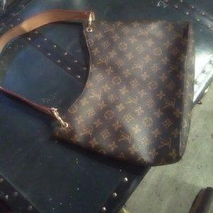 Authentic Louis Vuitton handbag serial ra2708-003